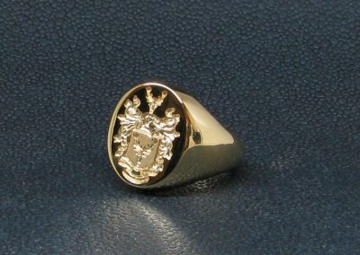 Gold signet ring, hallmarked and seal engraved with coat of arms