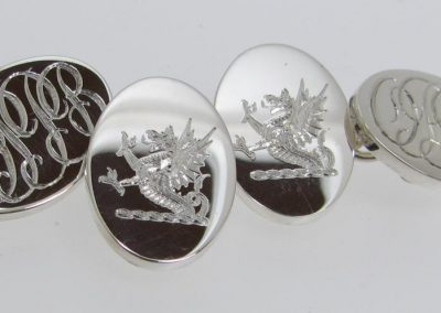 Sterling silver cuff links with engraved crest to front faces and entwined initials to the back