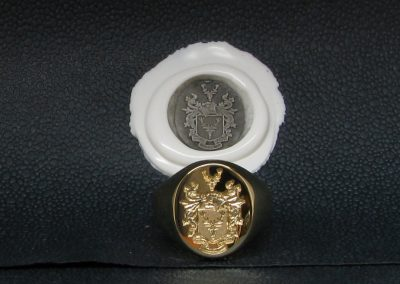 Gold signet ring, hallmarked and seal engraved with coat of arms with wax impression