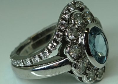 Diamond and gold halo wedding ring formatted around heirloom engagement ring
