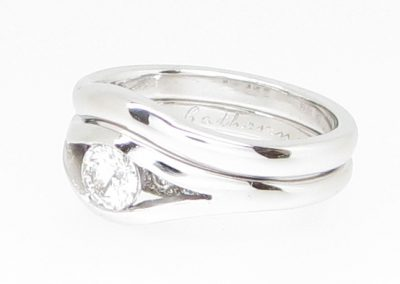 Platinum wedding ring shaped to fit bespoke platinum and diamond engagement ring
