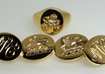 Gold cuff links and matching signet ring engraved with crest and initials in 18 carat