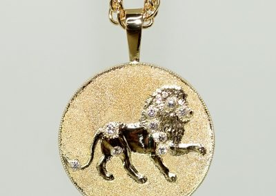 Gold lion pendant with diamonds