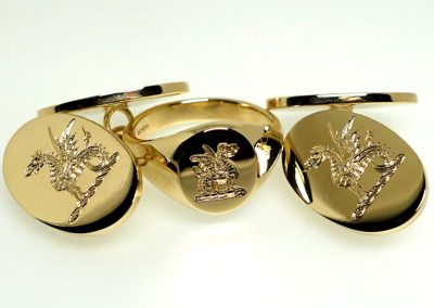 Gold signet ring seal engraved with family crest and with gold cuff links engraved with family crest for sight (hallmarked)