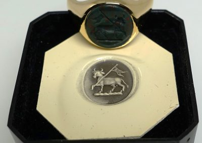 Gold signet ring set with bloodstone and hand engraved with crest