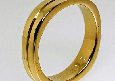Gold wedding ring in rounded square finish & highly polished