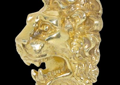 Lion facing head hand carved from sterling silver and gold plated