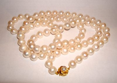 Opera length string of pearls with gold clasp