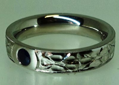 Sapphire set in platinum, engraved to add texture and flair