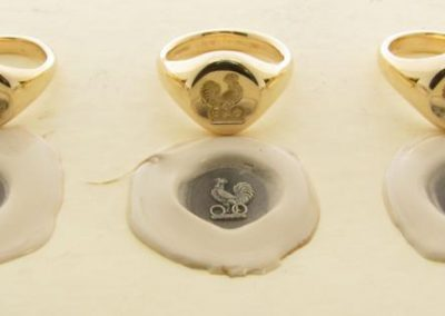 Gold signet rings, hallmarked and seal engraved with coat of arms for three brothers