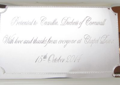 Silver plaque engraved for presentation to the Duchess of Cornwall