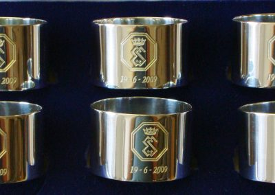 Sterling silver napkin rings engraved with crest
