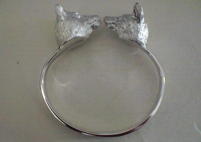 Sterling silver bangle adorned with 3D heads of wolf and a fox