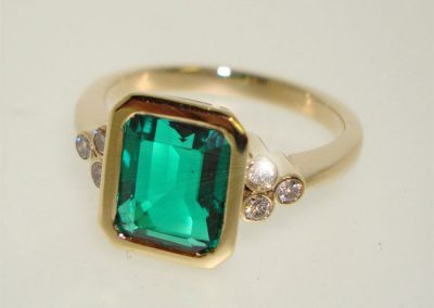 Emerald and diamond anniversary ring