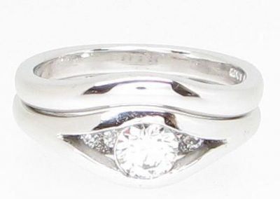 Engagement and shaped wedding ring in platinum