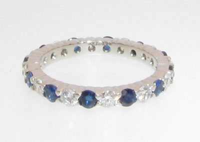 Diamond and sapphire eternity ring set in gold