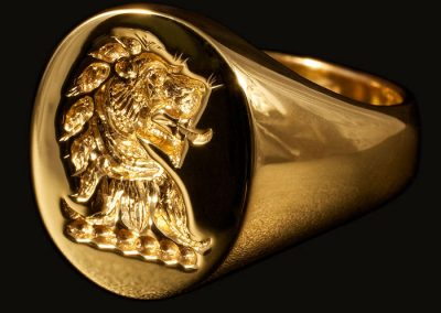 Gold signet ring, hallmarked and seal engraved with family crest