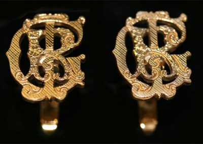 Gold cuff links, entwined initials hand pierced out with swivel backs