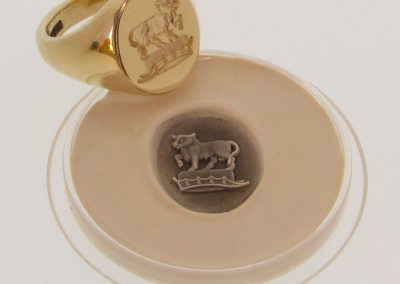Gold signet ring, hallmarked and seal engraved with family crest with wax impression