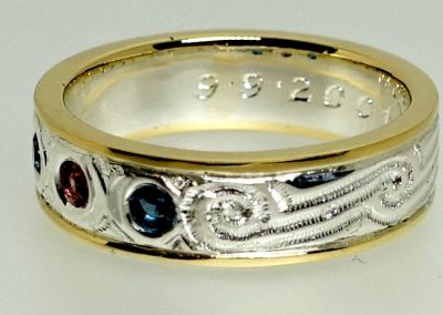 Gold wedding band with ruby and sapphires